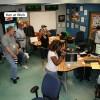 Ken Branson subtlety coordinates a media event in the Rutgers Coastal Ocean Observation Lab.