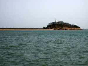 Lighthouse on the water's edge in Qingdao
