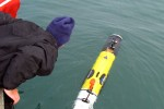 Jeff Lord and Greg Packard (WHOI technicians) deploy the REMUS AUV. (Credit: Al Plueddemann, WHOI)