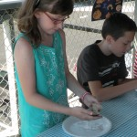 Katie and Luke show everyone how a clam is dissected.