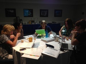 Teachers worked in groups to learn the lesson plans they will soon be teaching their students.