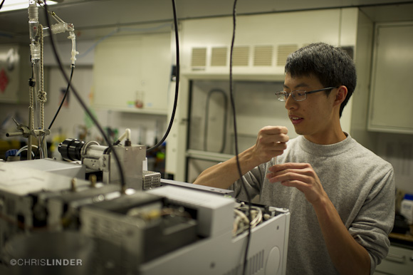 Menglei Chu working on the gas chromatograph